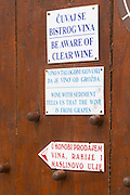 Winery with self service selling buying of the wine. Warning sign saying Be Aware (beware) of Clear Wine Wine With Sediment Tells us That the Wine is From Grapes... Potmje village, Dingac wine region, Peljesac peninsula. Dingac village and region. Peljesac peninsula. Dalmatian Coast, Croatia, Europe.
