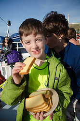 Max and Alex with Pound Cake on the Pride of Maui, Maui, Hawaii, US