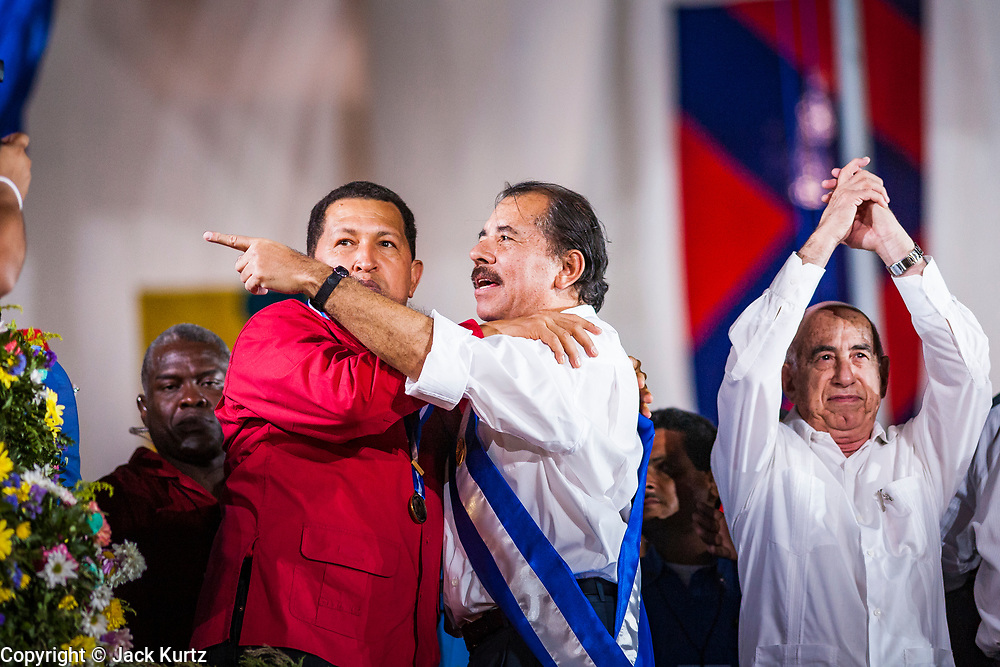 """10 JANUARY 2007 - MANAGUA, NICARAGUA:  HUGO CHAVEZ, President of Venezuela and DANIEL ORTEGA, President of Nicaragua at Ortega's inauguration. Ortega, the leader of the Sandanista Front, was sworn in as the President of Nicaragua Wednesday. Ortega and the Sandanistas ruled Nicaragua from their victory of """"Tacho"""" Somoza in 1979 until their defeat by Violetta Chamorro in the 1990 election.  Photo by Jack Kurtz"""