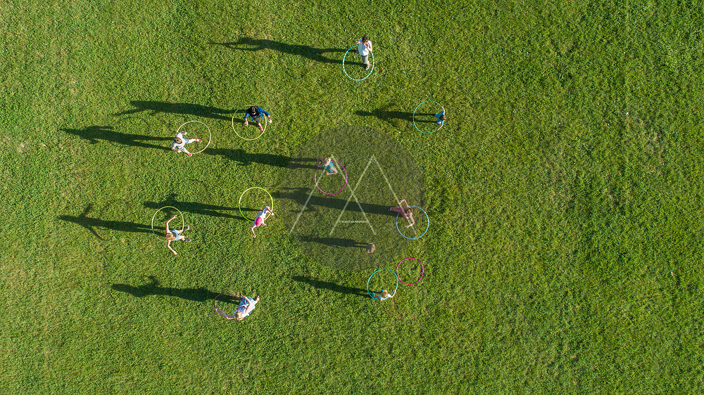 Aerial view of persons doing Hola Hoop in group at Tudmana Park, a public park in Zagreb downtown, Croatia.