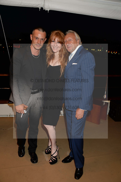 The Johnnie Walker Blue Label and David Gandy Drinks Reception aboard John Walker & Sons Voyager, St.Georges Stairs Tier, Butler's Wharf Pier, London, UK on 16th July 2013.<br /> Picture Shows:-Jonathan Saunders, Charlotte Tilbury, Harold Tillman.