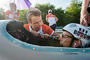Trainer Jeroen neemt nog even het protocol door met Wil Baselmans. In Schipkau doet het Human Power Team Delft en Amsterdam met fietser Wil Baselmans een poging het laagland sprintrecord te verbreken met de VeloX3. In september wil het team, dat bestaat uit studenten van de TU Delft en de VU Amsterdam, een poging doen het wereldrecord snelfietsen te verbreken, dat nu op 133 km/h staat tijdens de World Human Powered Speed Challenge.<br /> <br /> Trainer Jeroen talks to rider Wil Baselmans. At the Dekra test track in Lausitz the Human Power Team Delft and Amsterdam tries with rider Wil Baselmans  to set a new lowland sprint record on a bicycle. With the special recumbent bike the team, consisting of students of the TU Delft and the VU Amsterdam, also wants to set a new world record cycling in September at the World Human Powered Speed Challenge. The current speed record is 133 km/h.