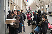"""March, 17th, 2020 - Paris, Ile-de-France, France: French citizens stand in line waiting to be able to enter a French Post Office, many wearing masks and plastic gloves, during the first day of near total lockdown imposed in France, to combat the spread of the Coronavirus. President of France, Emmanuel Macron, said the citizens must stay at home from midday on Tuesday for at least 15 days. He said """"We are at war, a public health war, certainly but we are at war, against an invisible and elusive enemy"""". All journeys outside the home unless justified for essential professional or health reasons are outlawed. Anyone flouting the new regulations would be punished. Nigel Dickinson"""
