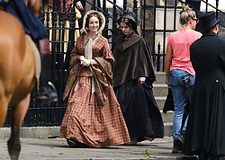 """Moray Place in Edinburgh's Georgian old town was turned into 19th century London for Julian Fellowes' new ITV show """"Belgravia"""".<br /> <br /> Pictured: Extras dressed in 19th century garb walk around during takes<br /> <br /> Alex Todd 