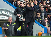 Football - 2016 / 2017 Premier League - Chelsea vs. Arsenal <br /> <br />  Chelsea Manager Antonio Conte grabs a hold of his assistant  and gives him instructions at Stamford Bridge.<br /> <br /> COLORSPORT/DANIEL BEARHAM