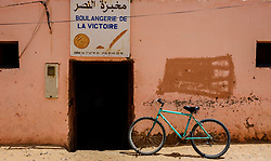 A bicycle parked out side a bakers shop (Boulangerie) in a street in Mhamid, Morocco<br /> <br /> (c) Andrew Wilson | Edinburgh Elite media