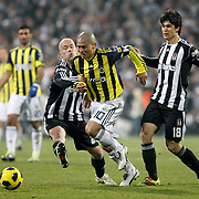 Besiktas's Fabian ERNST (L), Necip UYSAL (R) and Fenerbahce's Alexsandro de SOUZA (C) during their Turkish Superleague Derby match Besiktas between Fenerbahce at the Inonu Stadium at Dolmabahce in Istanbul Turkey on Sunday, 20 February 2011. Photo by TURKPIX