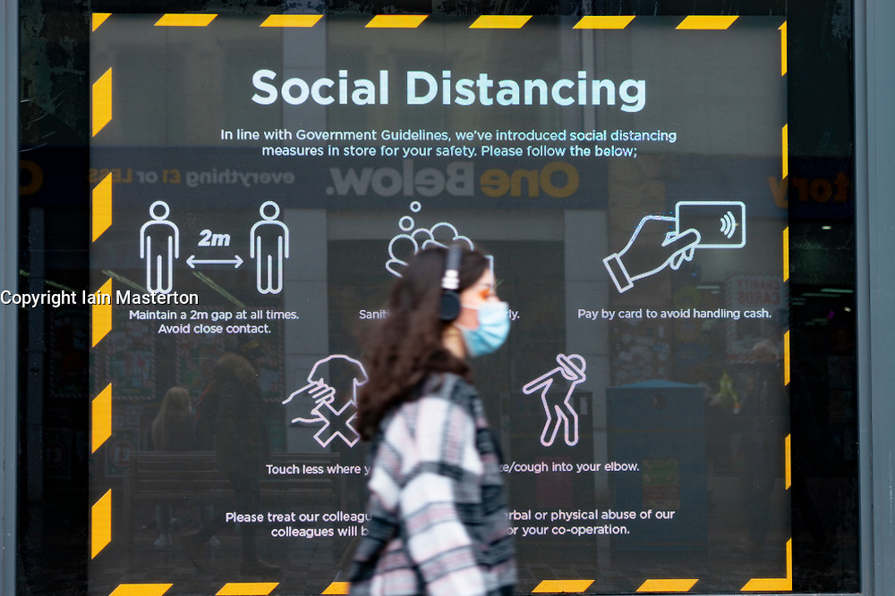 Glasgow,Scotland, UK. 2 November 2020. As Scotland enters new Coronavirus lockdown regulations the central belt and Glasgow are placed in Level 3 . Members of the public are seen out on the streets of central Glasgow for shopping and work. Pictured; Video display with Coronavirus message. Iain Masterton/Alamy Live News
