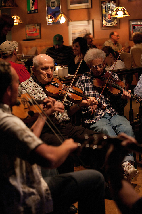 A group of French-Canadian musicians gather for an evening of Quebecois music at a restaurant in Burlington, Connecticut.