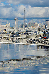 United States, Washington, Seattle. Sailboats and motorboats in a marina in Smith Cove with Seattle skyline in background.
