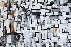 Perth, Scotland, UK. With the continuing Covid-19 lockdown in Scotland, household waste recycling and disposal depots remain closed although they are opening in England. Image shows many old refrigerators awaiting recycling at a Waste Electrical and Electronic Equipment (WEEE) plant in Perth. Iain Masterton/Alamy Live News
