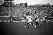 Lowry and Sheehy race to a breaking ball at the All Ireland Senior Football Final, between Offaly and Kerry. Offaly won the title by the narrowest of margins, 1-15 to 17 points, denying Kerry a record-breaking five in a row.<br /> 19 September 1982