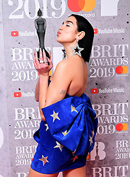 Dua Lipa with her Best British Single Brit Award in the press room at the Brit Awards 2019 at the O2 Arena, London.