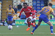 Tariqe Fosu-Henry of Charlton Athletic (11) skips past Ryan Sweeney of Mansfield Town (17) during the The FA Cup match between Mansfield Town and Charlton Athletic at the One Call Stadium, Mansfield, England on 11 November 2018.