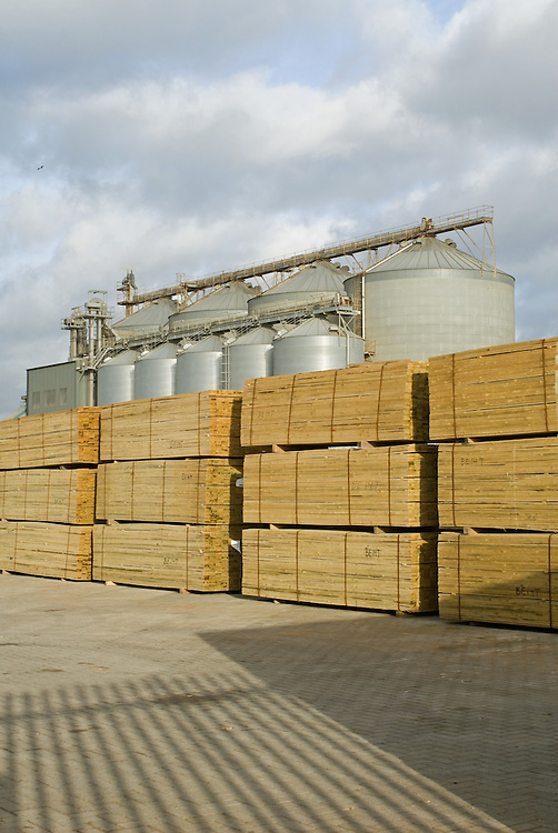 Grain silos and stacked timber at a port in England [Shoreham, East Sussex] 2008