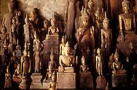 Buddhas in the Pak Ou cave on hte Mekong River, near Luang Prabang, Laos.