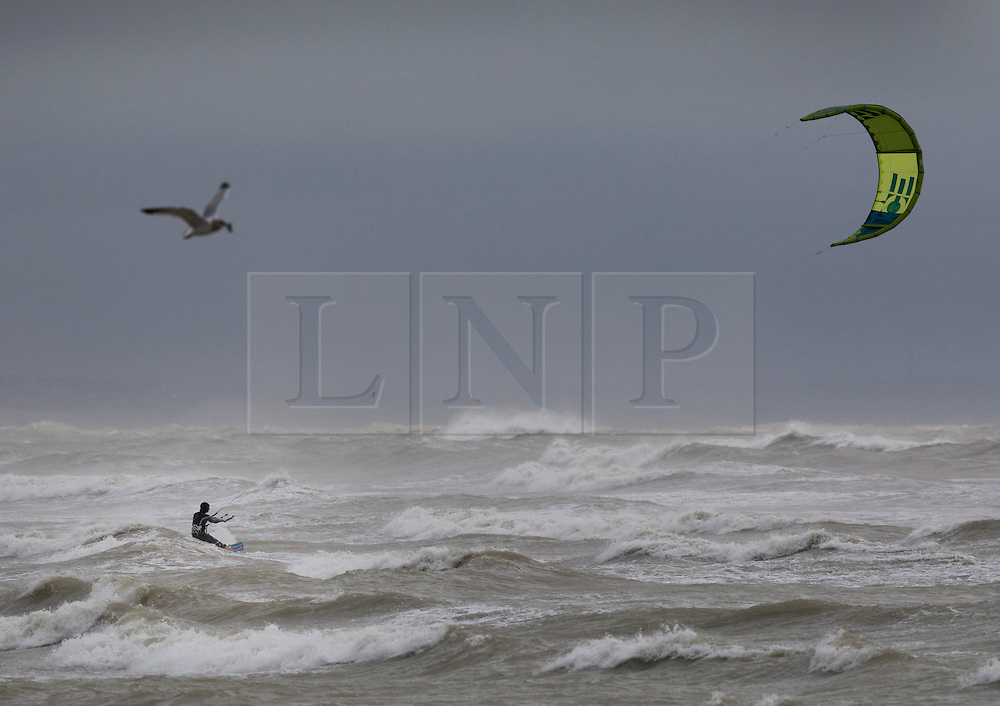 © Licensed to London News Pictures. 20/11/2016. Lancing, UK. A kite surfer takes advantage of Storm Angus waves off Lancing. The south east has experienced winds of up to 80 miles per hour as the first named storm of the season hits. Photo credit: Peter Macdiarmid/LNP