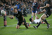 Aaron Smith of the All Blacks celebrates after scoring his first try as Ben Smith of the All Blacks arrives to congratulate him during  the third rugby test between the All Blacks and England played at Waikato Stadium in Hamilton during the Steinlager Series - All Blacks v England, Hamiton, 21 June 2014<br /> www.photosport.co.nz