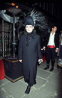 Boy George arriving at his Birthday bash with a camera in Hand