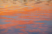 Bright, colorful sunrise reflections in a river