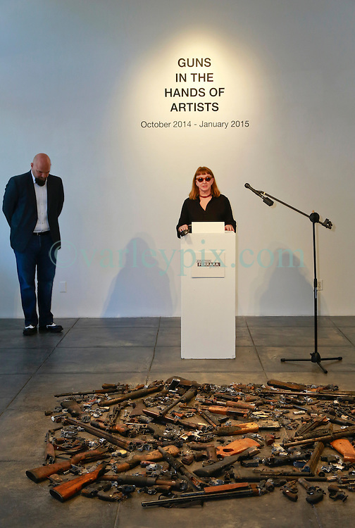 16 April 2014. Jonathan Ferrara Gallery, New Orleans, Louisiana. <br /> L/R; Jonathan Ferrara and artist Deborah Luster at the Jonathan Ferrara Gallery to announce the 'Guns In The Hands Of Artists' project where artists take parts from 190 destroyed weapons acquired by the New Orleans Police department through a buy-back program and convert them into art.  <br /> Photo; Charlie Varley/varleypix.com