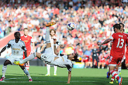 Swansea city's Chico Flores goes close to scoring with an overhead kick.  Barclays Premier League match, Southampton  v Swansea city at the St. Mary's stadium in Southampton on Sunday 6th Oct 2013. pic by Andrew Orchard, Andrew Orchard sports photography,