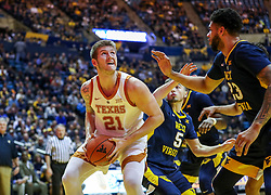 Feb 9, 2019; Morgantown, WV, USA; Texas Longhorns forward Dylan Osetkowski (21) makes a movie under the basket during the first half against the West Virginia Mountaineers at WVU Coliseum. Mandatory Credit: Ben Queen-USA TODAY Sports