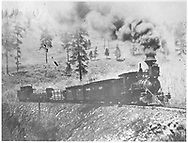 """RGS 2-8-0 #3 with four-car freight train nearing Millwood.<br /> RGS  Millwood, CO  post 1903<br /> In book """"RGS Story, The Vol. VIII: Over the Bridges? Dolores to Mancos"""" page 178<br /> See RD155-005 for enlargement of right half of photo.  It is also in """"RGS Story Vol. XII"""", p. 18."""