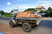 Old truck with minimal bodywork loaded with bricks. Dinh Quan District, Dong Nai Province, Vietnam