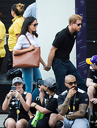 Prince Harry, right, arrives with his girlfriend Meghan Markle at the wheelchair tennis competition during the Invictus Games in Toronto, ON, Canada, Monday September 25, 2017. This is Prince Harry's first public appearance with Markle. Photo by Nathan Denette/CP/ABACAPRESS.COM