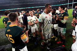 England's Courtney Lawes (front) walks through the South Africa guard of honour after the Autumn International match at Twickenham Stadium, London.