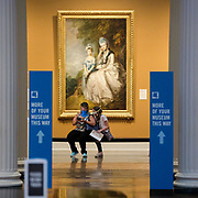 """Monica Clark-Eagle, left, sits with daughter, Alyssa Meszaros, 12, both of Waterville, Ohio, in front of the 1771 oil on canvas painting, """"Hester, Countess of Sussex, and Her Daughter,"""" by British artist Thomas Gainsborough at the Toledo Museum of Art in Toledo on Tuesday, June 23, 2020. The museum reopened today after closing earlier due the coronavirus pandemic. Since the pandemic is still ongoing, the museum has adapted to try to keep visitors and staff as safe as possible THE BLADE/KURT STEISS"""