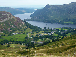 Embargoed to 0001 Saturday July 29 File photo dated 04/09/13 of a view of Glenridding and Ullswater in the Lake District, as government funding for England's much-loved national parks is on track to fall by two-fifths by the end of the decade, new analysis shows.