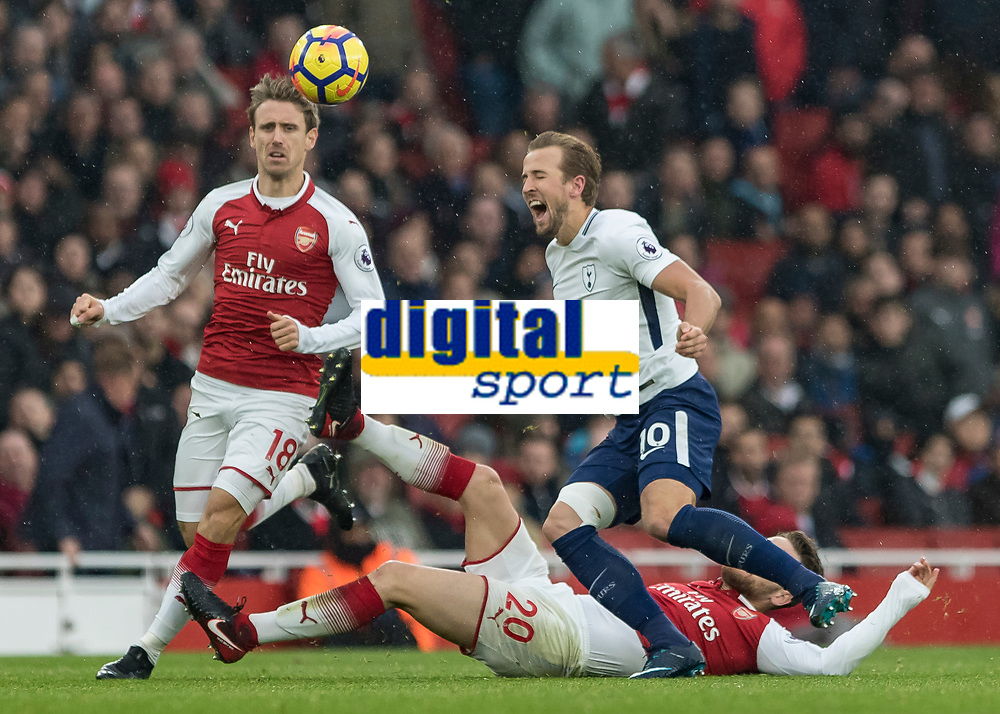 Football - 2017 / 2018 Premier League - Arsenal vs. Tottenham Hotspur<br /> <br /> Harry Kane (Tottenham FC)  cries out in pain as he is fouled by Shkodran Mustafi (Arsenal FC) at the Emirates.<br /> <br /> COLORSPORT/DANIEL BEARHAM
