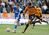 Photo: Ed Godden.<br />Wolverhampton Wanderers v Cardiff City. Coca Cola Championship. 11/03/2006. <br />Jason Koumas (L) strides past Wolves player Joleon Lescott.