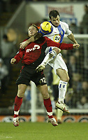 Photo: Aidan Ellis.<br /> Blackburn Rovers v Bayer Leverkusen. UEFA Cup, 2nd Leg. 22/02/2007.<br /> Rovers Ryan Nelsen (R) in an Aerial battle with Bayer's Adrej Voronin