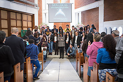 18 November 2018, Bogotá, Colombia: Rev. John Rojas blesses a group of staff from the church-run school. The church of San Lucas ('Saint Lucas') of the Evangelical Lutheran Church of Colombia, brings together a congregation of some 100 people in the southern areas of Bogotá. Located in the Kennedy area, the church has recently celebrated 50 years. As part of its ministry, the church runs a school and college, The Colegio Evangelico Luterano de Colombia (CELCO) San Lucas, offering education to just over 1,000 students aged 3-18. The school started as a social initiative offering care for children aged 0-4 in Bogotá's less wealthy neighbourhood, allowing the parents opportunities to go to work. 36 years after its foundation, the school employs 56 staff, of which 36 are teachers.