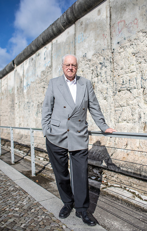 German journalist Peter Brinkmann poses for a portrait near a section of the Berlin Wall Memorial at Niederkirchnerstraße (street) in Berlin, Germany, 10 September, 2019. (Photo: Omer Messinger)