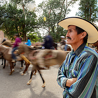 072114  Adron Gardner/Independent<br /> <br /> Gilbertine King of Iyanbito arrives with horse roundup and Rangeland Improvement act protestors at the Navajo Nation Tribal Council chambers in Window Rock Monday.