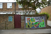 Gentrification protest banner in Cressingham Gardens on 20th September 2015 in South London, United Kingdom. Cressingham Gardens is a council garden estate, located on the southern edge of Brockwell Park. It comprises of 306 dwellings and built to the design of Lambeth Borough Council architect Edward Hollamby in the early 1970s. In 2012, Lambeth Council proposed regeneration of the estate, a decision highly opposed by many residents. Since the announcement, the highly motivated campaign group Save Cressingham Gardens has been active.