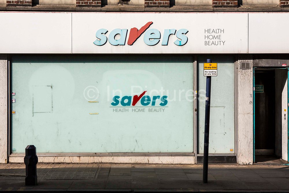 A run down old Savers shop on a high-street in Hackney, London, United Kingdom.  Many high-streets across the country have seen shop closures due to the credit crunch financial crisis. According to the Centre for Retail Research, the number of shops in Britain is predicted to fall by more than a fifth by 2018.