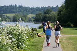 © Licensed to London News Pictures. 15/06/2021. Henley-on-Thames, UK. Two women jogging in the early morning sun, along the bank of the River Thames at Henley-on-Thames in Oxfordshire on a hot summer's morning. Photo credit: Ben Cawthra/LNP