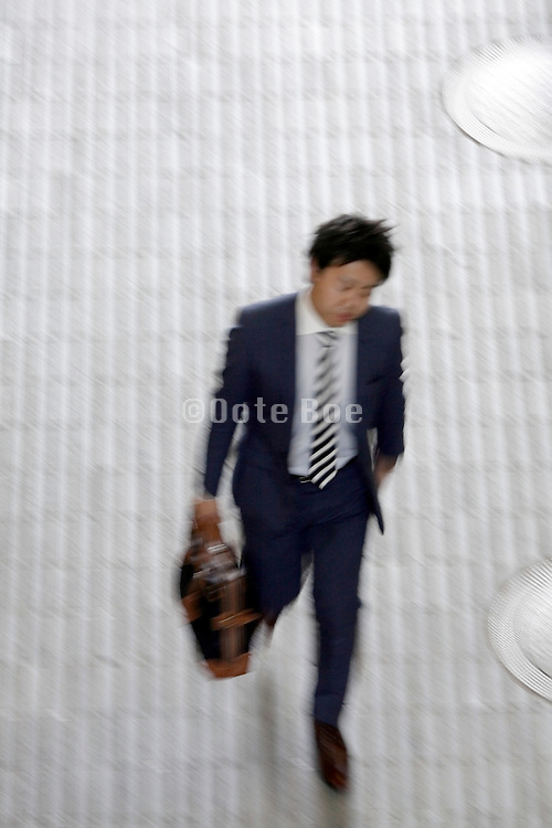 overhead view of businessman rushing to his destination