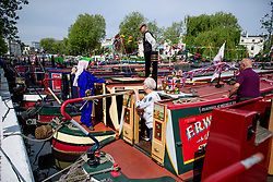 © Licensed to London News Pictures.30/04/2017.London, UK. Narrowboat owners in conversation as the Canalway Cavalcade festival takes place in Little Venice, London on Saturday, 30 April 2017. Inland Waterways Association's annual gathering of canal boats brings around 130 decorated boats together in Little Venice's canals on May bank holiday weekend. Photo credit: Ben Cawthra/LNP