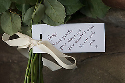 © Licensed to London News Pictures. 26/12/2016. Goring-, UK. A card attached to a floral tribute is left at the door of George Michael's Oxfordshire home. Pop superstar George Michael died on Christmas day at his Oxfordshire home on the River Thames aged 53. Photo credit: Peter Macdiarmid/LNP