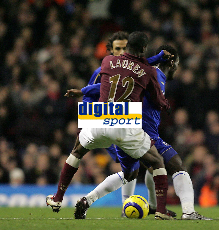 Photo: Lee Earle.<br /> Arsenal v Chelsea. The Barclays Premiership. 18/12/2005. Chelsea's Mickael Essien (R) clashes with Lauren.