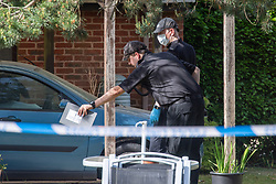 © Licensed to London News Pictures. 21/05/2020. Beaconsfield, UK. Specialist search team members look for evidence at a property on North Drive. Thames Valley Police were called to North Drive, Beaconsfield at around 00:01 BST on Thursday 21/05/2020 to a report of a stabbing. A man in his forties had sustained injuries consistent with stab wounds and was taken to hospital. Photo credit: Peter Manning/LNP