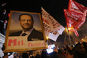 """Rally for the winner of the French Presidential elections, incoming President Francois Hollande of the Socialist Party at the Bastille, Paris, on Sunday night May 7th 2012. Francois Hollande beat Nicolas Sarkozy 52% to 48% in the second and final round of the French Presidential Elections///Socialist Party supporters holding a portrait of Francois Hollande reading """"Moi President"""", with flags reading change """"Changement"""" and """"Front Gauche"""" left front"""
