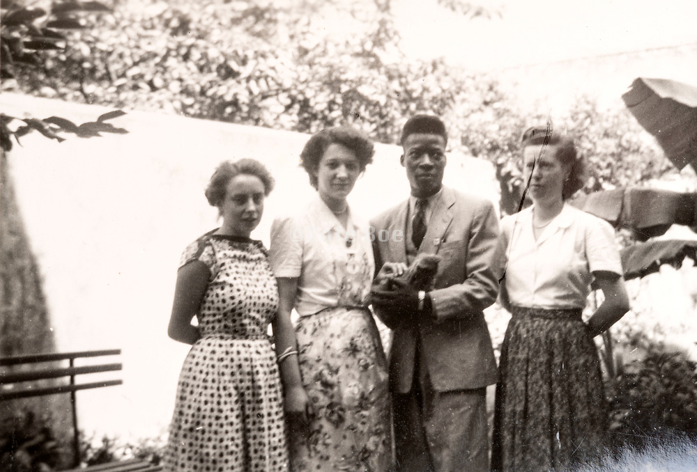 interracial couple with friends France 1952