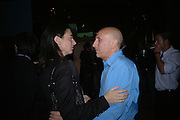 Mary McCartney and Brian Clarke, Established and Sons UK Launch during Design Week. The Bus Depot, Hertford Road. Hoxton. 22 September 2005.  ONE TIME USE ONLY - DO NOT ARCHIVE © Copyright Photograph by Dafydd Jones 66 Stockwell Park Rd. London SW9 0DA Tel 020 7733 0108 www.dafjones.com
